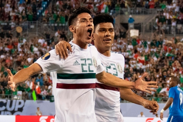 Mexico's Uriel Antuna (R) celebrates after scoring against Martinique during their CONCACAF Gold Cup group stage football match at Bank of America Stadium in Charlotte, North Carolina, on June 23, 2019. (Photo by Jim WATSON / AFP)