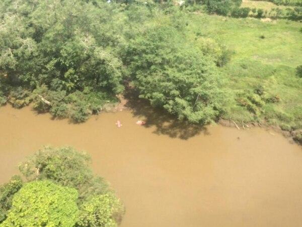 Un helicóptero se sumó a la búsqueda de la niña en el río Sarapiquí, pero de momento no hay resultados positivos.