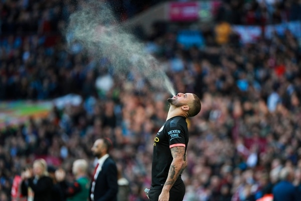 Manchester City's Kyle Walker sprays liquid in the air prior to the League Cup soccer match final between Aston Villa and Manchester City, at Wembley stadium, in London, England, Sunday, March 1, 2020. (AP Photo/Ian Walton)