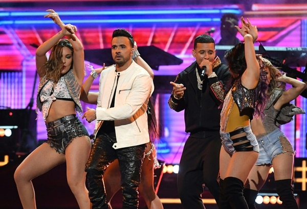 Luis Fonsi (2nd L) and Daddy Yankee (3rd R) perform their hit song