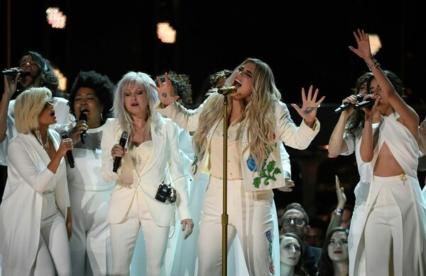 Kesha (C) performs with Bebe Rexha (L), Cindy Lauper (3rd L) and Camila Cabello (R) during the 60th Annual Grammy Awards show on January 28, 2018, in New York. / AFP PHOTO / Timothy A. CLARY
