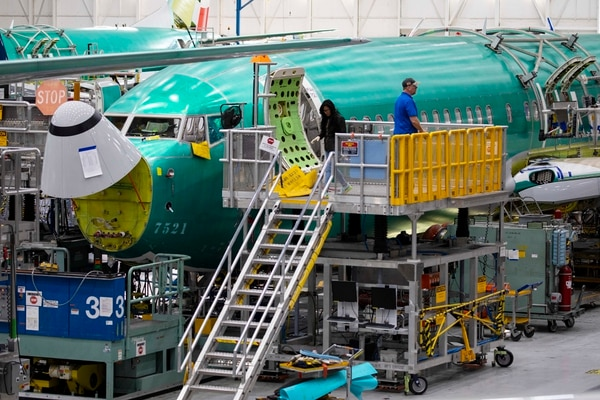 FILE -- 737 MAX planes on the assembly line at the Boeing plant in Renton, Wash., March 27, 2019. Preliminary findings suggest that the pilots on the Ethiopian Airlines flight that crashed in March initially followed the correct procedures before the plane went down. (Ruth Fremson/The New York Times)