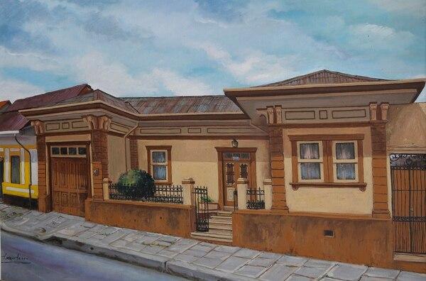 Don Raúl guarda una pintura de su antigua casa en barrio Amón, donde conoció y creció con Felicia. Foto: Mayela López