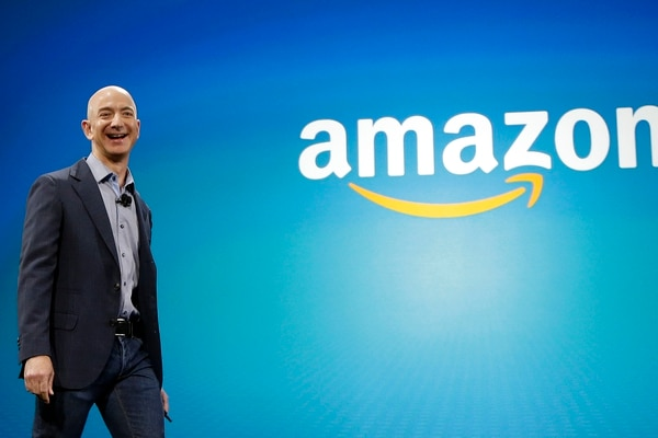 FILE - In this June 16, 2014, file photo, Amazon CEO Jeff Bezos walks onstage for the launch of the new Amazon Fire Phone, in Seattle. In a milestone announced Tuesday, March 6, 2018, Bezos has become the first person to amass a fortune surpassing $100 billion in Forbes magazine's annual ranking of the world's moguls. (AP Photo/Ted S. Warren, File)