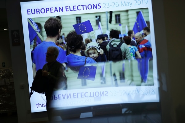 A man walks past a board announcing incoming European elections at the European Parliament in Brussels, Wednesday, May 22, 2019. Some 400 million Europeans from 28 countries will head to the polls May 23-26 to choose lawmakers to represent them at the European Parliament for the next five years. (AP Photo/Francisco Seco)