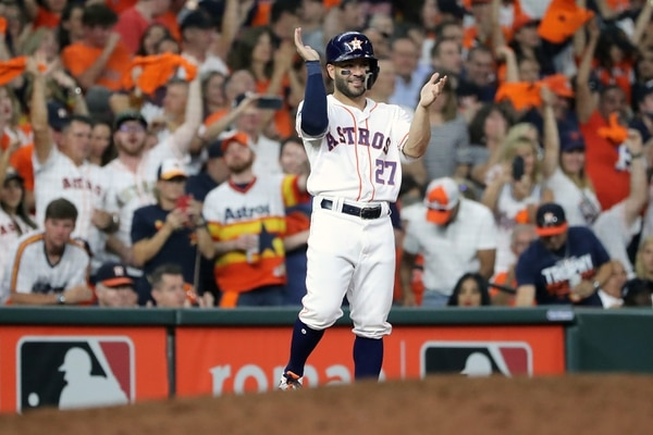 HOUSTON, TEXAS - OCTOBER 19: Jose Altuve #27 of the Houston Astros reacts to a single by teammate Michael Brantley (not pictured) against the New York Yankees during the sixth inning in game six of the American League Championship Series at Minute Maid Park on October 19, 2019 in Houston, Texas. Elsa/Getty Images/AFP == FOR NEWSPAPERS, INTERNET, TELCOS & TELEVISION USE ONLY==