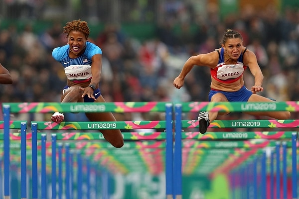 LIMA, PERU - AUGUST 08: (FROM L TO R) Yanique Thompson of Jamaica, Sharika Nelvis of United States and Andrea Vargas of Costa Rica compete in Women's 100m Hurdles Final on Day 13 of Lima 2019 Pan American Games at Athletics Stadium of Villa Deportiva Nacional on August 08, 2019 in Lima, Peru. (Photo by Patrick Smith/Getty Images)/ AFP