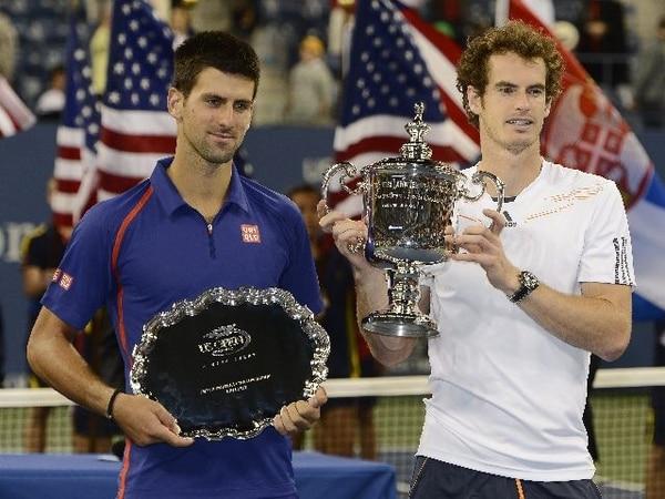 El británico y campeón Andy Murray junto al serbio y subcampeón, Novak Djokovic (izq.), en Nueva York. | EFE