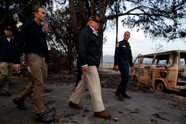 President Donald Trump visits a neighborhood impacted by the Wolsey Fire, Saturday, Nov. 17, 2018, in Malibu, Calif. At left is FEMA Administrator Brock Long. (AP Photo/Evan Vucci)