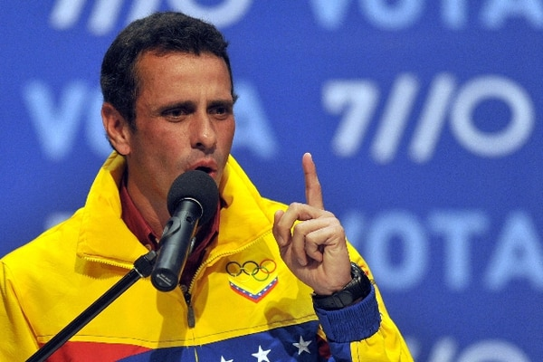 Venezulean presidential candidate Henrique Capriles speaks to supporters after receiving news of his defeat in Caracas on October 7, 2012. According to the National Electoral Council, Venezuelan President Hugo Chavez was reelected with 54.42% of the votes, beating opposition candidate Henrique Capriles, who obtained 44.47%. AFP PHOTO/Eitan Abramovich