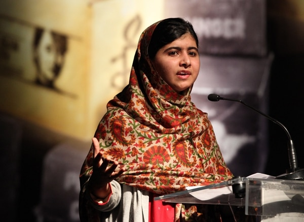 (FILES) Photo taken on September 17, 2013 shows Pakistani student who was shot in the head by the Pakistani Taliban, Malala Yousafzai addressing the assembly before receiving the Amnesty International Ambassador of Conscience Award for 2013 at the Manison House in Dublin. Malala Yousafzai, Pakistan's teenage activist, on October 10, 2013 was awarded the European Parliament's prestigious Sakharov human rights prize. AFP PHOTO/ PETER MUHLY