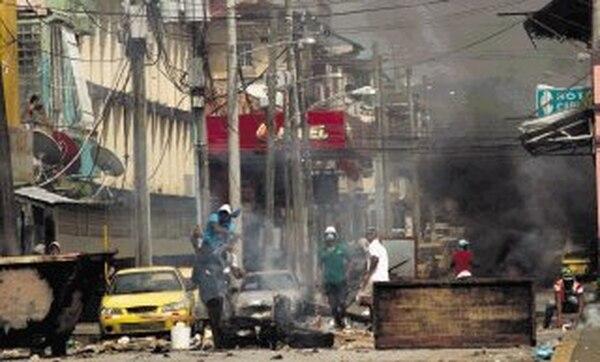 La Zona Libre de Colón registró fuertes disturbios que dejaron un saldo de tres muertos. | AFP