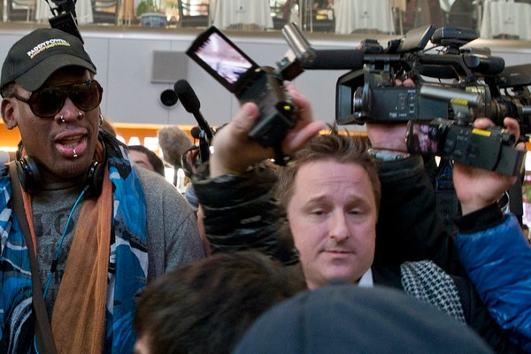FILE - In this Dec. 19, 2013, file photo, Michael Spavor, center, an entrepreneur, is seen with former NBA star Dennis Rodman, left, on the arrival at the capital airport for a flight to North Korea, in Beijing, China. A second Canadian man has gone missing in China and is feared detained in what appears to be retaliation for Canada's arrest of a top executive of telecommunications giant Huawei, Canadian authorities said late Wednesday, Dec. 12, 2018. Canada's Global Affairs department identified its missing citizen as Spavor, an entrepreneur who is one of the only Westerners to have ever met North Korean leader Kim Jong Un. Spavor's disappearance follows China's detention of a former Canadian diplomat in Beijing earlier this week.(AP Photo/Ng Han Guan, File)