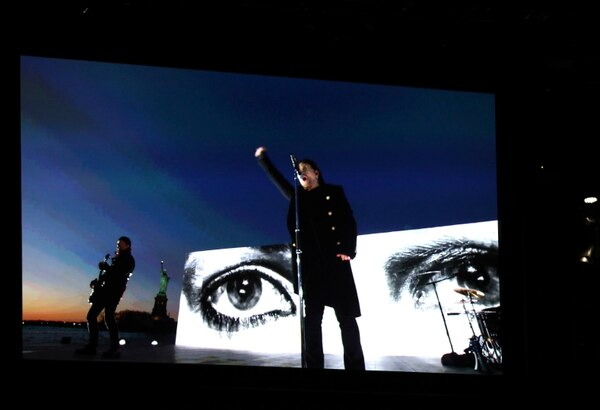 U2 appears on screen as they perform