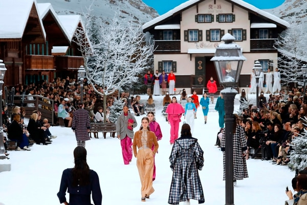 Models present creations by Chanel during the Women's Fall-Winter 2019/2020 Ready-to-Wear collection fashion show at the Grand Palais turned into a wintry village in Paris, on March 5, 2019. (Photo by FRANCOIS GUILLOT / AFP)