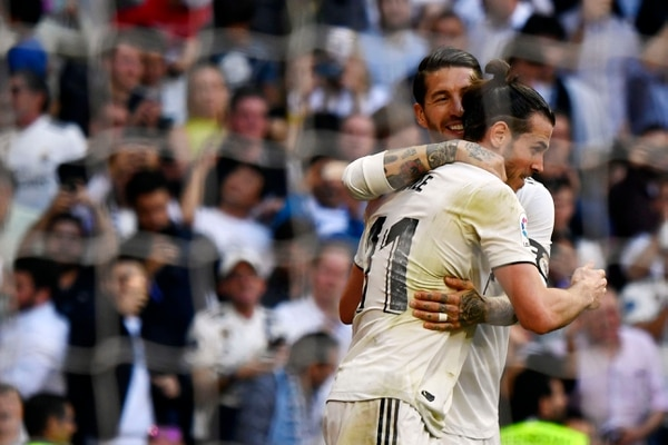 Real Madrid's Welsh forward Gareth Bale (R) celebrates his goal with Real Madrid's Spanish defender Sergio Ramos during the Spanish league football match between Real Madrid CF and RC Celta de Vigo at the Santiago Bernabeu stadium in Madrid on March 16, 2019. (Photo by GABRIEL BOUYS / AFP)
