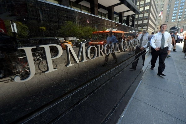 (FILES) This file photo taken on August 14, 2013 shows people walking by JP Morgan Chase & Company headquarters in New York. JPMorgan Chase is spending billions on new compliance staff and programs to address a wave of regulatory scrutiny after recent problems, according to a Wall Street Journal report on September 13, 2013. The US banking behemoth plans to spend an additional $4 billion and direct some 5,000 additional employees to work on compliance, the Journal said, citing people close to the bank.The efforts come as the government probes the bank's compliance with US regulations. AFP PHOTO / FILES / Emmanuel Dunand