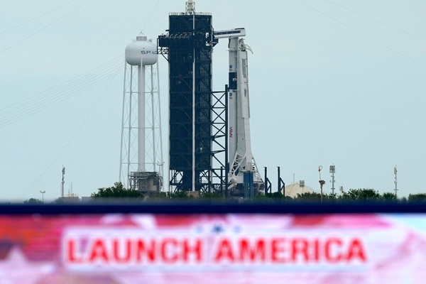 The SpaceX Falcon 9, with the Crew Dragon spacecraft on top of the rocket, sits on Launch Pad 39-A, Tuesday, May 26, 2020, at Kennedy Space Center in Cape Canaveral, Fla. Two astronauts will fly on the SpaceX Demo-2 mission to the International Space Station scheduled for launch on May 27. (AP Photo/David J. Phillip)