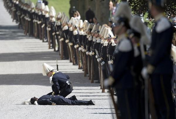 El día caluroso habría provocado el desmayo de un guarda. | AFP