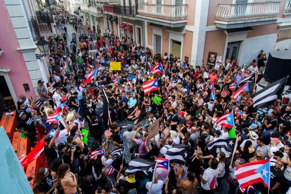Desde que trascendió el chat entre el gobernador y su grupo de amigos, hace nueve días, las protestas no cesan en Puerto Rico. La imagen fue captada en San Juan, este domingo 21 de julio.Foto: AP, Dennis M. Rivera Pichardo.