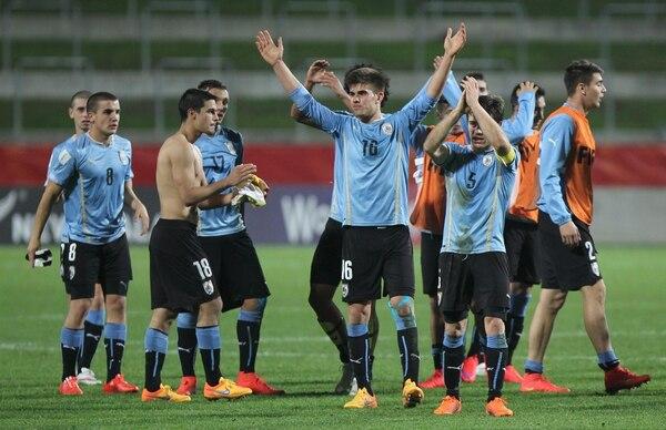 Uruguay y Mali empataron a un tanto en Hamilton y ambos sellaron su clasificación para octavos con cuatro puntos.