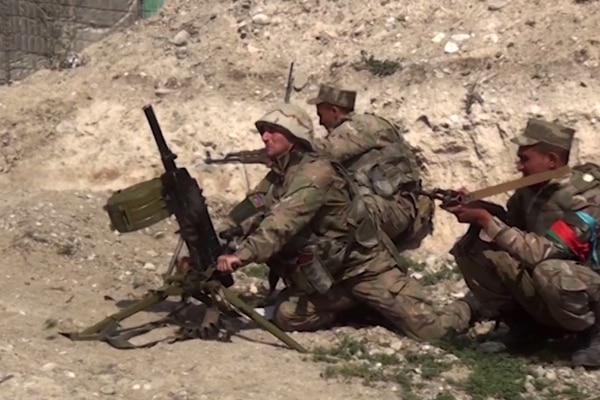 An image grab taken from a video made available on the official web site of the Azerbaijani Defence Ministry on September 28, 2020, allegedly shows Azeri troops conducting a combat operation during clashes between Armenian separatists and Azerbaijan in the breakaway region of Nagorno-Karabakh. (Photo by Handout / Azerbaijani Defence Ministry / AFP) / RESTRICTED TO EDITORIAL USE - MANDATORY CREDIT