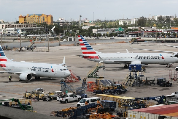 MIAMI, FL - MARCH 14: Two grounded American Airlines Boeing 737 Max 8 are seen parked at Miami International Airport on March 14, 2019 in Miami, Florida. The Federal Aviation Administration grounded the entire United States Boeing 737 Max fleet. Joe Raedle/Getty Images/AFP == FOR NEWSPAPERS, INTERNET, TELCOS & TELEVISION USE ONLY==