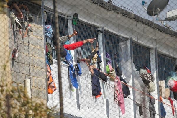 Reclusos del penal de La Modelo, en Bogotá, protestaban este domingo 22 de marzo del 2020.