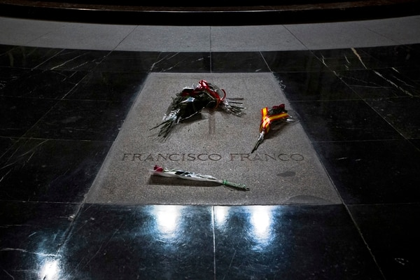 FILE - In this Nov. 20, 2014 file photo, flowers lay on the tomb of Spanish former dictator General Francisco Franco in a mausoleum in the Valle de los Caidos (Valley of the Fallen), near Madrid, Spain. Spanish lawmakers on Thursday, May 11, 2017 have voted in favor of moving the remains of dictator Gen. Francisco Franco from the Valley of the Fallen mausoleum, a measure that has long been rejected by the conservative governing Popular Party and has reopened debate relating to one of Spain's most painful episodes, the 1936-39 Civil War and its aftermath. (AP Photo/Daniel Ochoa de Olza, File)