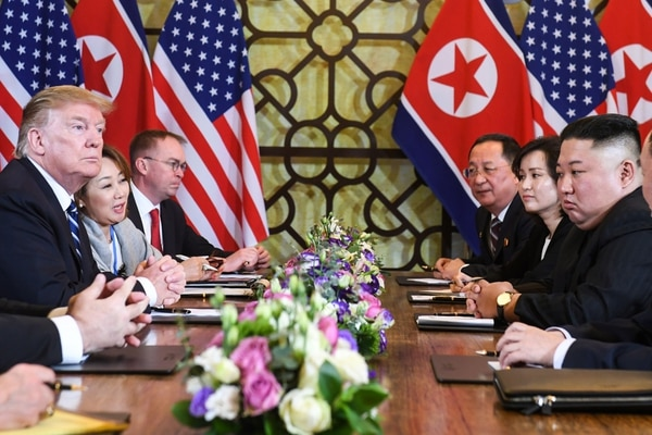 US President Donald Trump (L) and North Korea's leader Kim Jong Un (R) hold a bilateral meeting during the second US-North Korea summit at the Sofitel Legend Metropole hotel in Hanoi on February 28, 2019. (Photo by Saul LOEB / AFP)