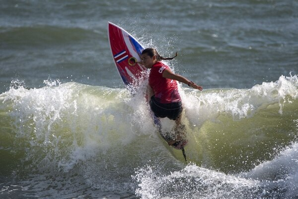 Costa Rica's Brisa Hennessy rides a wave during the women's Surfing Third round at the Tsurigasaki Surfing Beach, in Chiba, on July 26, 2021 during the Tokyo 2020 Olympic Games. (Photo by Olivier MORIN / AFP)
