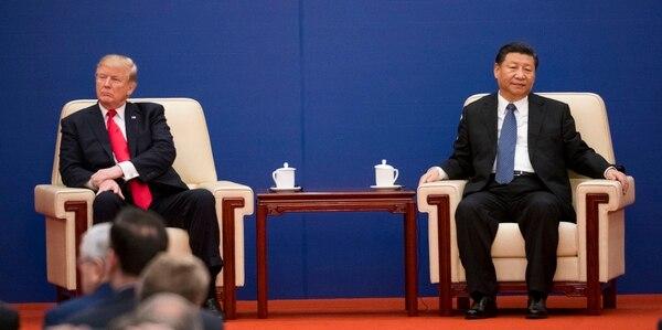 El presidente Donald Trump y el presidente Xi Jinping de China comparten un escenario durante una cumbre en Beijing, el 9 de noviembre de 2017. Foto: Doug Mills / The New York Times.