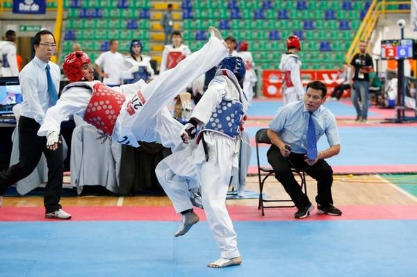 Heiner Oviedo derrotó al hondureño Alberto Galeas 10-4 en lo que fue su segunda pelea del día. A la postre el tico se conformó con la medalla de bronce en la categoría de menos 58 kilogramos, ayer en Hatillo. | GERMÁN FONSECA