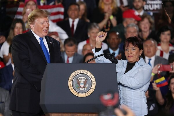 MIAMI, FLORIDA - FEBRUARY 18: President Donald Trump stands with Aminta Perez, whose son Oscar Perez was killed by the Venezuelan military, as they attend a rally at Florida International University on February 18, 2019 in Miami, Florida. President Trump spoke about the ongoing crisis in Venezuela. Joe Raedle/Getty Images/AFP == FOR NEWSPAPERS, INTERNET, TELCOS & TELEVISION USE ONLY==