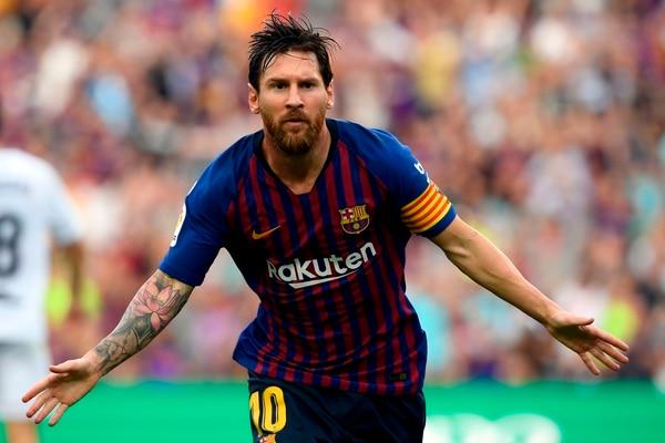 Lionel Messi anotó en la victoria de 8-2 del FC Barcelona frente al Huesca. (Photo by LLUIS GENE / AFP)