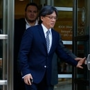 Eduardo Li of Costa Rica, leaves the Court of the Eastern District in Brooklyn, New York on August 3, 2016 following a preliminary hearing in the FIFA scandal. Eight defendants who have pleaded not guilty in the sweeping FIFA corruption scandal should go on trial in New York in September or October 2017, a US federal judge recommended August 2. Judge Raymond Dearie told a court hearing it was no longer realistic to expect the defendants, who between them have negotiated bonds worth millions to live under house arrest, to face trial in spring 2017. / AFP PHOTO / KENA BETANCUR