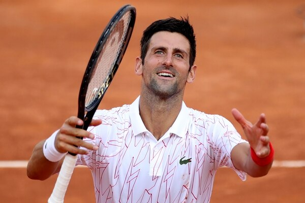 TOPSHOT - Serbia's Novak Djokovic celebrates after victory over Norway's Casper Ruud in their semi final match of the Men's Italian Open at Foro Italico in Rome on September 20, 2020. (Photo by Clive Brunskill / POOL / AFP)