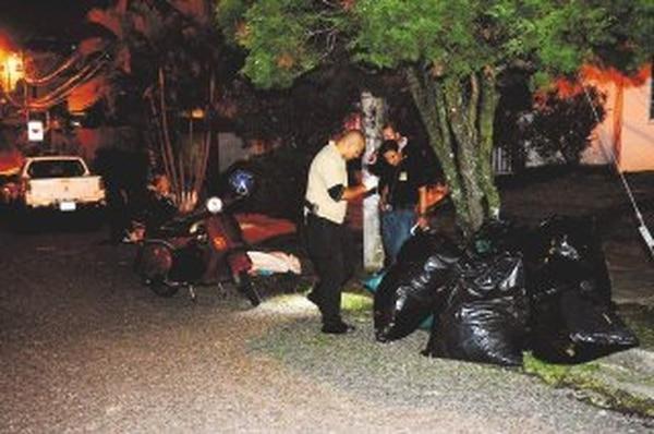 El OIJ llevó el cuerpo a la Morgue y detuvo a un sujeto. | MARVIN CARAVACA.