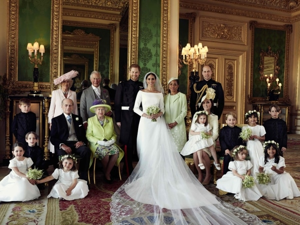 Meghan y Enrique junto con sus familiares. Fotografía: AFP.