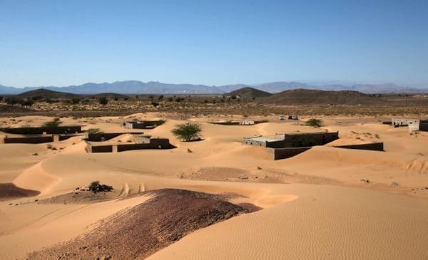 El avance de los desiertos, como este en el sultanato de Omán, es una de las consecuencias del cambio en el clima mundial. AFP