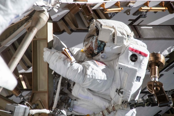 (FILES) In this file photo taken on March 22, 2019 This image made available by NASA shows astronaut Anne McClain working on March 22, 2019, on the International Space Station's Port-4 truss structure during a six-hour, 39-minute spacewalk to upgrade the orbital complex's power storage capacity. - The US space agency NASA scrapped on March 25, 2019, a planned historic spacewalk by two women astronauts, citing a lack of available spacesuits that would fit them at the International Space Station. Christina Koch will now perform tasks in space Friday with fellow American Nick Hague -- instead of Anne McClain as originally planned. Had Koch and McClain done their spacewalk together, it would have been the first ever by two women astronauts. Until now, male-only or mixed male-female teams had conducted spacewalk since the space station was assembled in 1998 -- 214 spacewalks until now. (Photo by HO / NASA / AFP) / RESTRICTED TO EDITORIAL USE - MANDATORY CREDIT