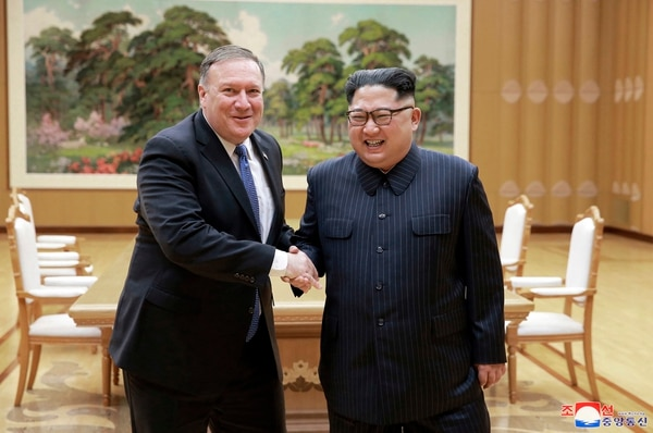 FILE - In this May 9, 2018, file photo provided by the North Korean government, U.S. Secretary of State Mike Pompeo, left, shakes hands with North Korean leader Kim Jong Un during a meeting at Workers' Party of Korea headquarters in Pyongyang, North Korea. Korean language watermark on image as provided by source reads: