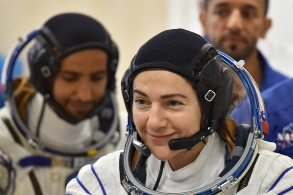 (FILES) In this file photo taken on September 25, 2019, International Space Station (ISS) crew member US astronaut Jessica Meir smiles during a testing of her space suits before boarding a Soyuz rocket to the ISS at the Russian-leased Baikonur cosmodrome in Kazakhstan. - After an infamous spacesuit flub earlier this year that resulted in accusations of sexism, NASA now plans to carry out the first all-female spacewalk this week, it said Tuesday. Astronauts Christina Koch and Jessica Meir will venture outside the International Space Station either October 17 or October 18, 2019, to replace a power controller unit that failed over the weekend. (Photo by Vyacheslav OSELEDKO / AFP)