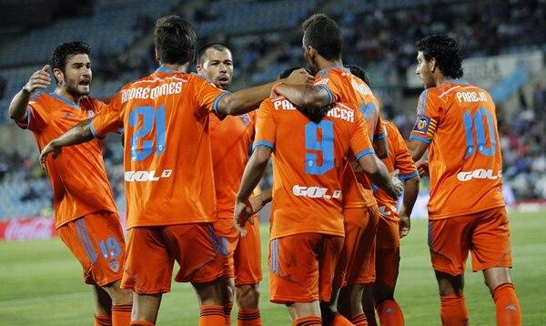Los jugadores del Valencia celebran una de las anotaciones ante el Getafe.