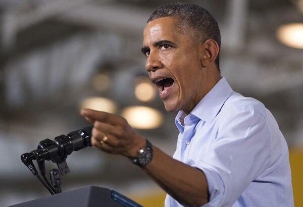 El sábado, Obama estuvo en un mitin en Detroit, en apoyo al candidato al Senado Gary Peters, y al aspirante a gobernador de Míchigan, Mark Schauer. | AFP