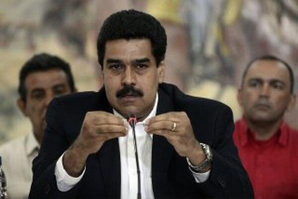 Nicolás Maduro sigue descontento por la reunión de Santos con Capriles. | ARCHIVO