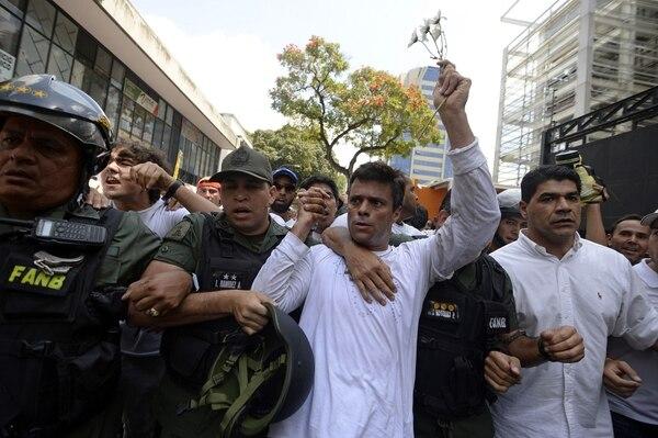 Leopoldo López al momento de su detención, el 18 de marzo del 2014, en Caracas.