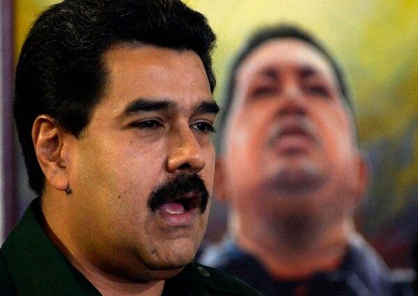 El presidente Nicolás Maduro habla durante el encuentro que mantuvo el miércoles con gobernadores y alcaldes en el palacio de Miraflores.   AFP