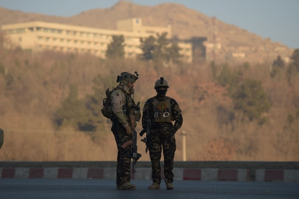 Afghan security forces keep watch near the Intercontinental Hotel following an attack in Kabul on January 21, 2018. Gunmen killed at least five people and wounded eight others in an attack on Kabul's Intercontinental Hotel, an official said on January 21, as the eleven hours-long siege continued.
