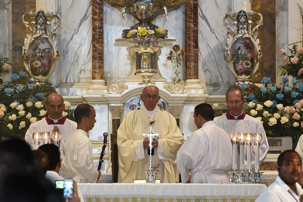 Pope Francis gives mass at the basilica to Our Lady of Charity of El Cobre, the patron saint of Cuba -- a mixed-race Mary that symbolizes the island's intertwined Spanish and African roots -- in Santiago de Cuba, in eastern Cuba, on September 22, 2015. The pontiff's eight-day tour will also take him to the United States. The pope, who played a key role in brokering the two countries' recent rapprochement, will conclude his trip to Cuba with a mass and a blessing in second city Santiago, then depart for his first-ever visit to the United States. AFP PHOTO / FILIPPO MONTEFORTE